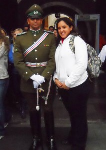 Natalie Nazar next to a guard at La Moneda in Santiago, Chile during her 2010 study abroad trip
