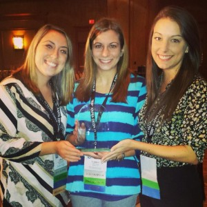 Allison Baricko (Co-President), Lauren Rosa(Former President), and Maria Dunas (Co-President) holding the ACE award