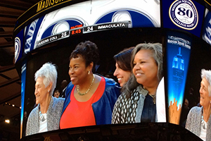 Beverly (far right) is captured on the Garden's Jumbotron with (from left) her coach at Queens, Lucille Kyvallos, and fellow teammates Gail Marquis, a 1976 Olympic medalist, and Donna Orender, a former WNBA president.