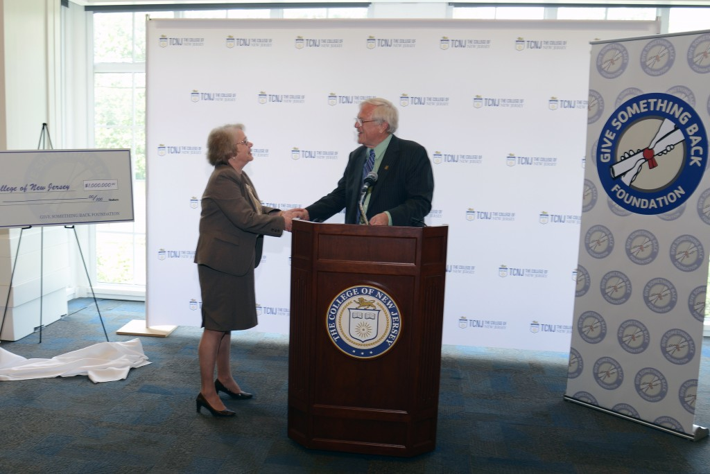 President Gitenstein accepts a check for $1 million from Robert Carr