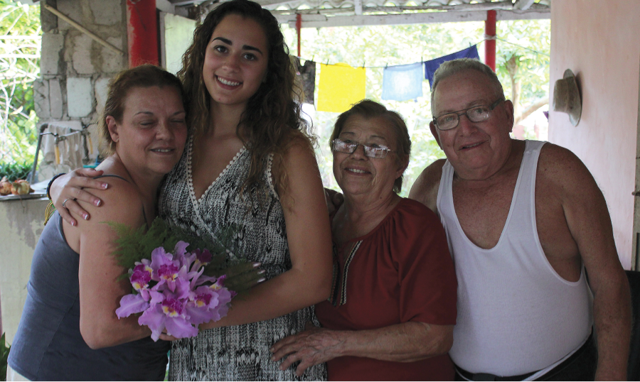 Galindo (second from left) met her great aunt and uncle, Isolina and Roberto (right), and (far left) their daughter, Bettis. Photo by Matt Furman
