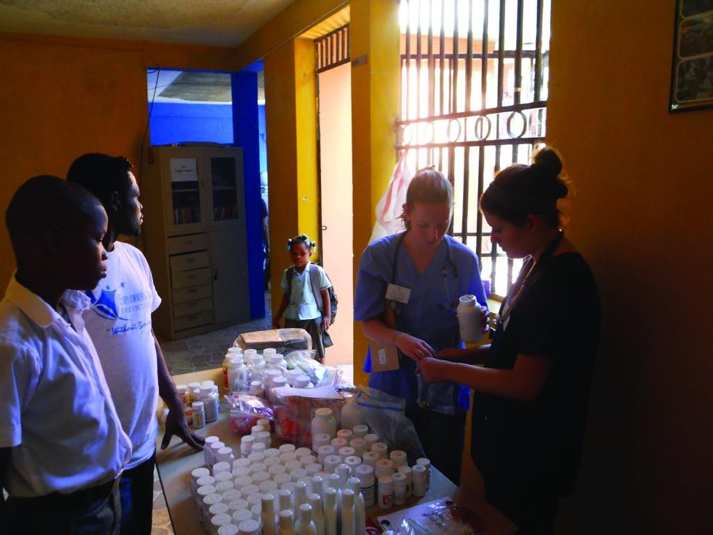 TCNJ students fill prescriptions in a pop-up clinic pharmacy.