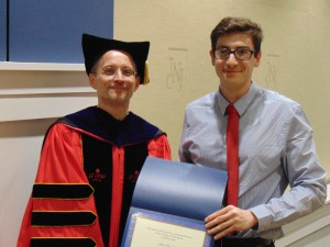 Cavalllaro receives the award from John Sisko, Interim Dean of the School of Humanities and Social Sciences. Photo by x