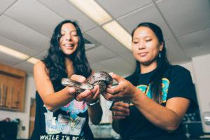 tcnj students holding snake