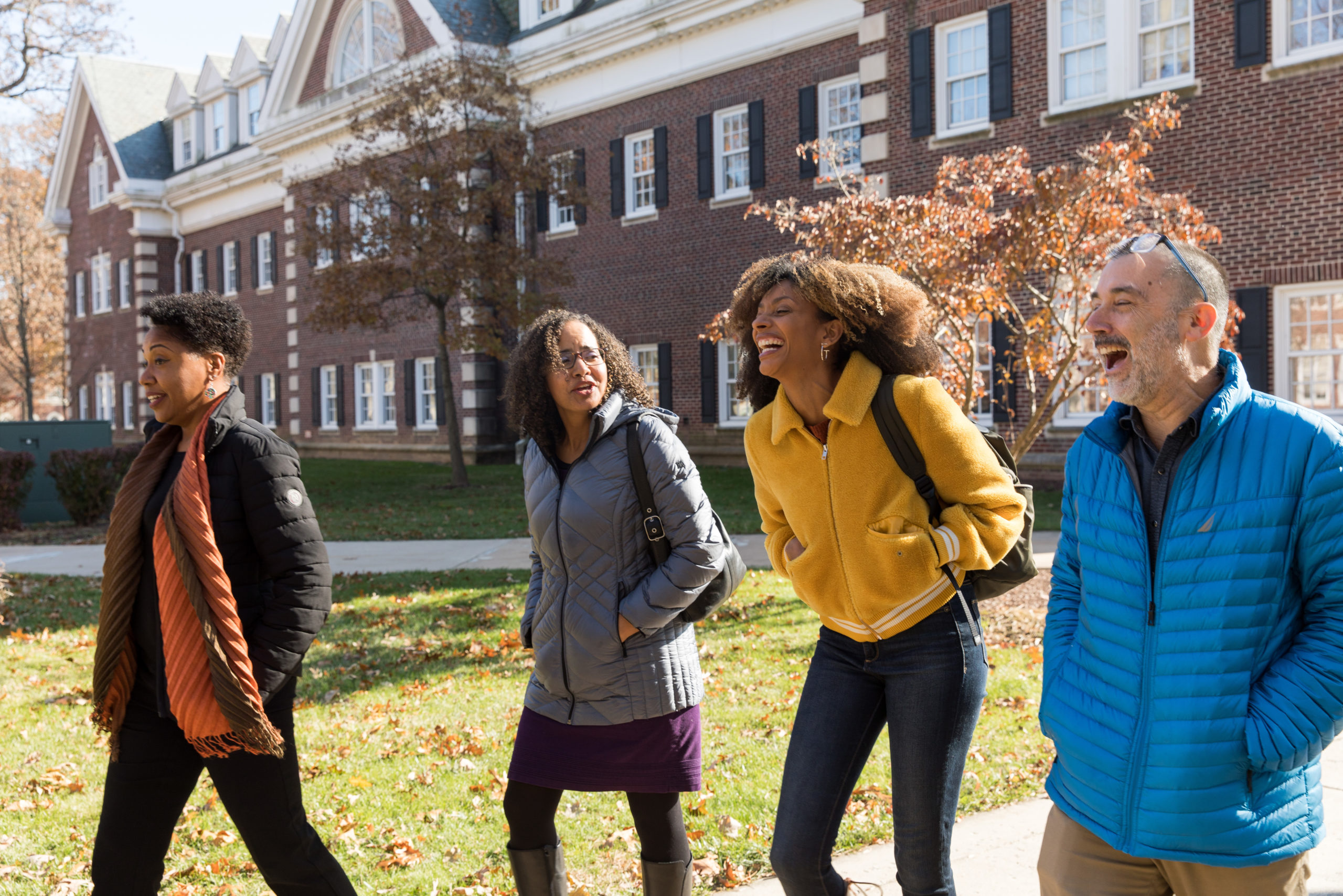 Professors Cassandra Jackson, Winnifred Brown-Glaude, Juda Bennett, and Piper Williams walk to Kendall Hall before their Skype call with Roxane Gay.