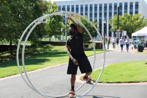 Trenton Circus Squad member uses the wheel in a performance.