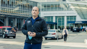 Dan Egan stands on a busy sidewalk in front of Massachusetts General Hospital.